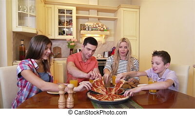 Pizza Eaters - Family of four enjoying their pizza lunch