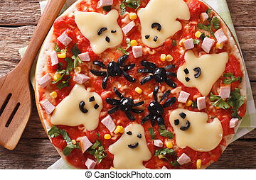pizza for Halloween with ham, cheese and olives close-up....