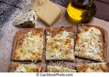Pizza four cheese with oregano and olive oil. quattro fromaggi.