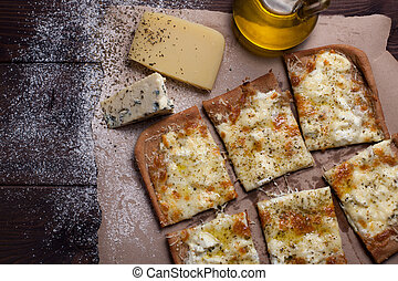 Pizza four cheese with oregano and olive oil. quattro fromaggi
