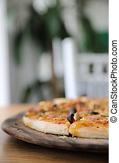 pizza ham and mushroom on wood background