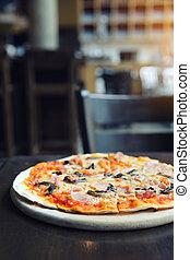 pizza ham and mushroom on wood