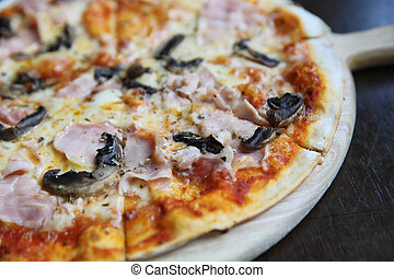 pizza ham and mushroom on wood
