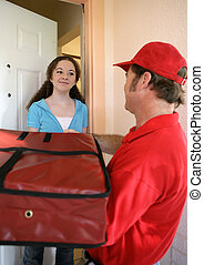 Pizza Home Delivery - A woman receiving a pizza delivery.