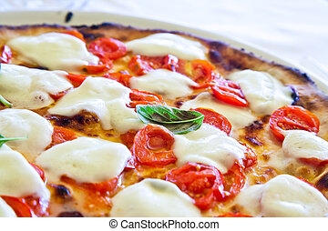 This is a true Italian Pizza. Traditional Pizza Margherita served in a Capri's restaurant, Naples Gulf, Italy.