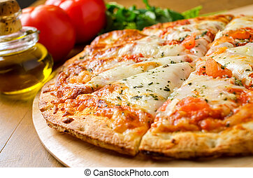 A freshly baked pizza margherita with olive oil, tomatoes, fresh basil, and mozzarella cheese.