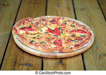 pizza on a wooden plate