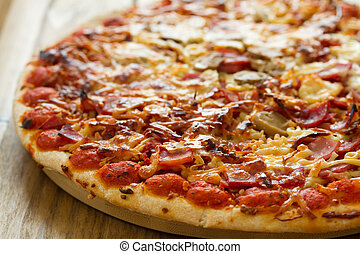pizza on brown wooden background