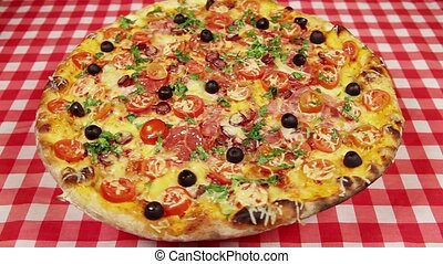 Pizza on the red tablecloth - Low angle view video of...