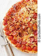 pizza on white wooden background