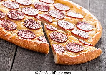Pizza Pepperoni on Wood Background
