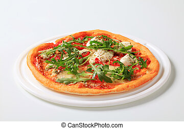 Cheese pizza sprinkled with fresh arugula