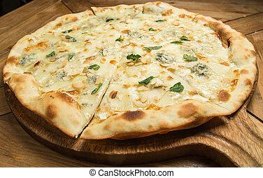 Pizza quattro fromaggi on a wooden board