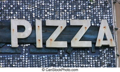 Pizza Sign - A cool, retro-style PIZZA sign glitters in the...