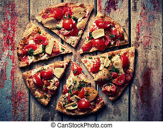 Pizza slices on grunge wooden table