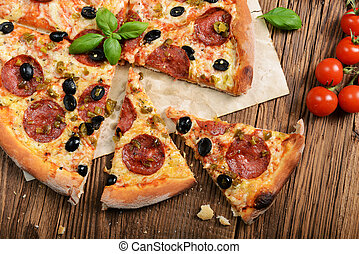 Pizza - Tasty pizza with olives and salami