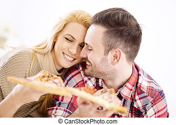 Pizza time! - Portrait of an happy couple.They are laughing...