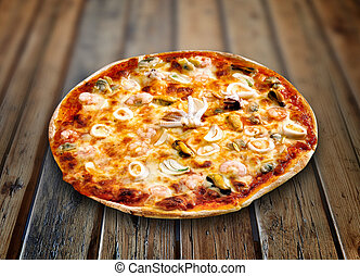 Pizza Tutti Frutti on a textured wooden table