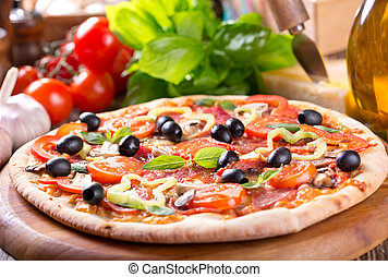 pizza with bacon, vegetables and olives