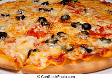 Pizza with black olives and melted cheese, close-up