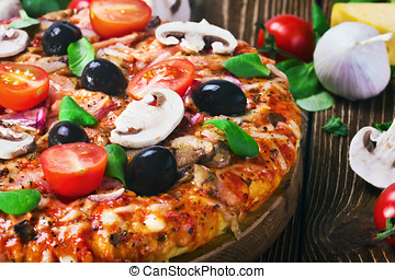 pizza with cheese and mushrooms on the table