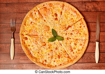 Pizza with cheese on the board