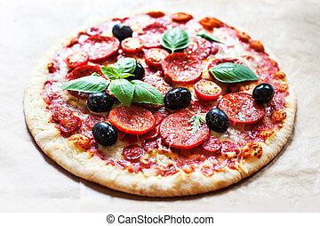 Pizza with cherry tomatoes and ham. Hot Original Italian...