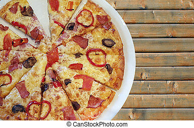Pizza with ham, bell peppers, black olives
