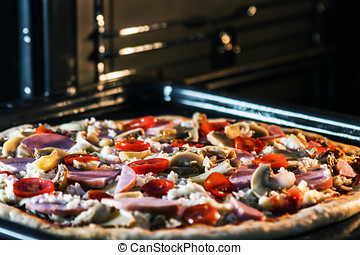 pizza with mushrooms, ham and mozzarella cooked baking
