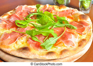 Pizza with parma ham topping
