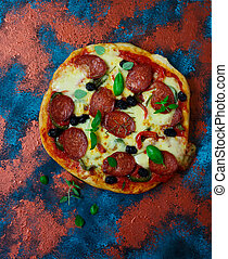 Pizza with pepper and chorizo.. Top view.