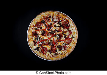 pizza with Pepperoni vegetables isolated on a black background