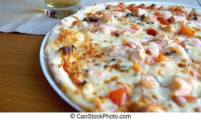 Pizza with seafood. Tuna and shrimps.