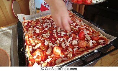 pizza with tomatoes is prepared