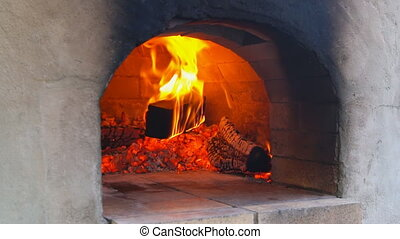 Pizzas baking in an open firewood oven - oven for baking...