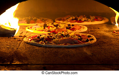 Pizzas in the oven