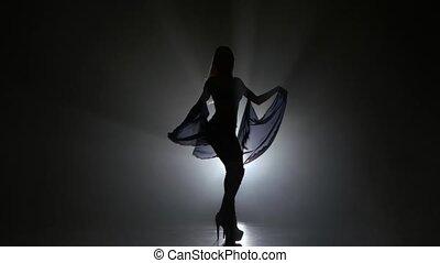 PJ girl dancer in studio with smoke against black background...