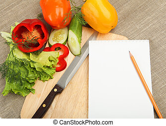 Place for cooking vegetables, vegetables, and a notebook. ...