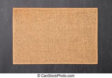 Place mat on black chalkboard texture.