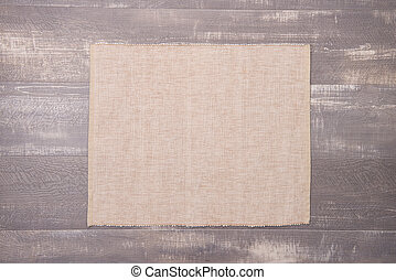 Place mat on wooden deck table.