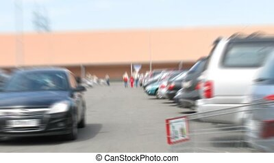 Place of parking of cars about shop, day. Time lapse.