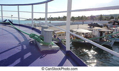 Place on the boat where ship is tied with ropes for dock -...