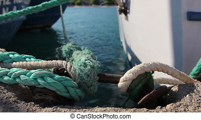 Place on the pier where ships are tied with ropes - Place...