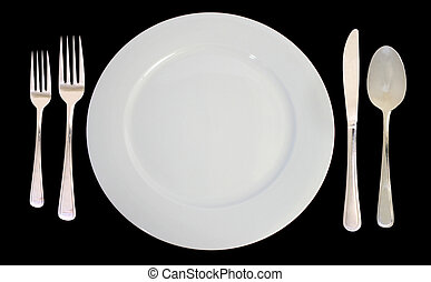 This is a place setting including one white dinner plate and silverware on a black background.
