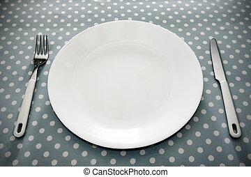 Place setting white plate and grey polka dot