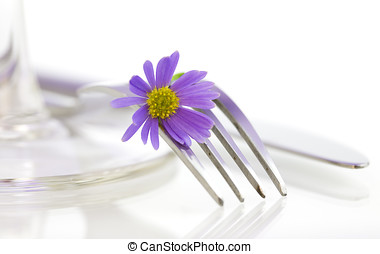 Place setting with purple flower. Health and diet concept