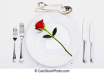 Place setting with red rose
