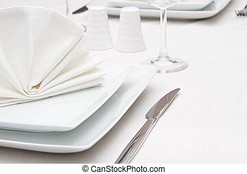 Place setting with white plates