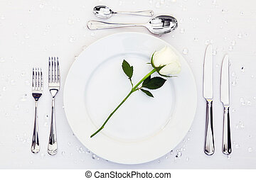 Place setting with white rose