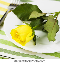 Place setting with yellow rose